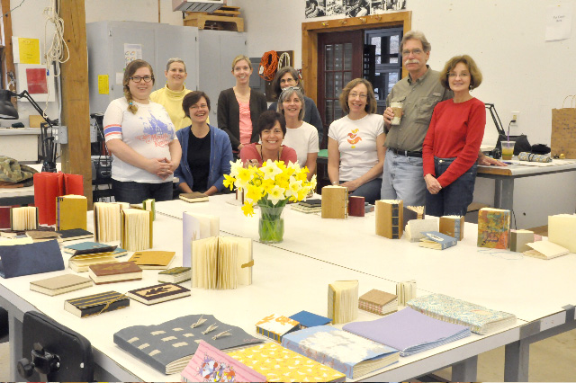 The book class (minus two) with their books