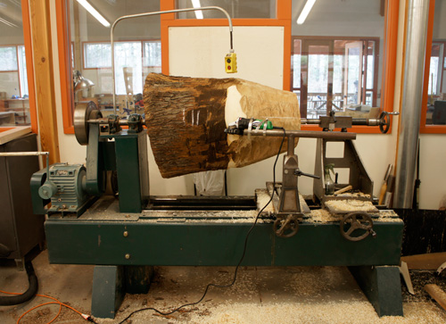 Big log on the lathe