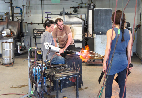 Soto and Cordova blowing glass