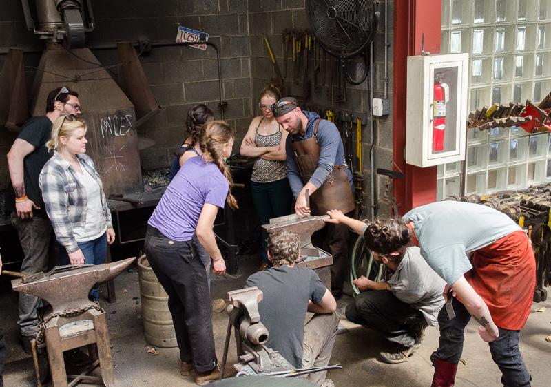 andrew hayes in the penland iron studio